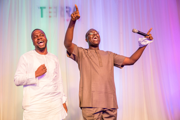 Chude Jideonwo and Adebola Williams in worship